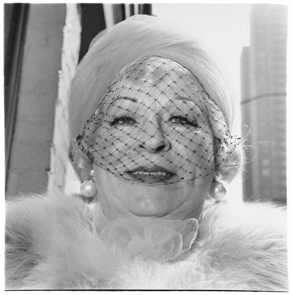 woman with a veil on fifth avenue nyc 1968 c the estate of diane arbus