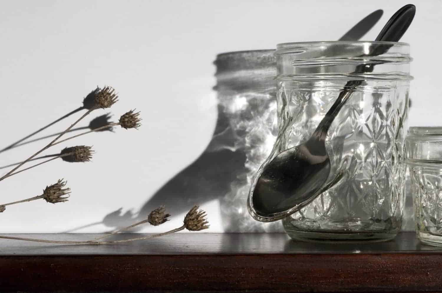 """""""What's good for the goose is good for the gander,"""" Jelly jars, cutlery, dried flowers, wood frame, 22.5 x 29 x 4 inches, photo credit: Elizabeth Torgerson-Lamark"""