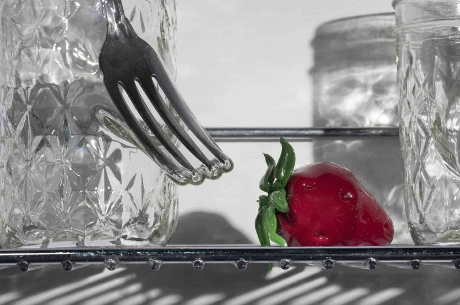 """Detail of """"From small beginnings come great things,"""" Jelly jars, cutlery, flame worked glass, stainless steel, 12 x 16 x 6 inches, photo credit: Elizabeth Torgerson-Lamark"""